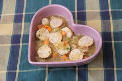 Stew of cabbage with sausage Stock Photo