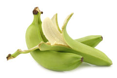 Fresh still unripe  bananas and a peeled one Stock Images