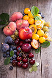 Fresh stone fruits on wooden table Stock Photos
