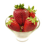 Fresh strawberrie in glass bowl closeup.Isolated. Stock Photo