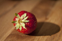 Fresh strawberrie on wooden table Royalty Free Stock Images
