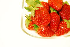 Fresh strawberries. Strawberries in a bowl on a white background Royalty Free Stock Photos