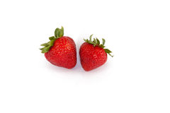 Fresh Strawberries. A photo of two fresh strawberries isolated on a white background Stock Photo