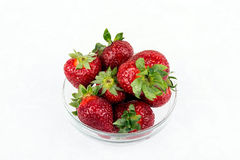 Fresh strawberries. Some fresh strawberries in glass container royalty free stock images