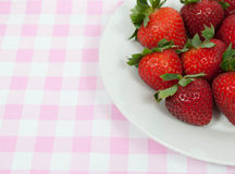 Fresh Strawberries. On a light pink tablecloth Royalty Free Stock Photo