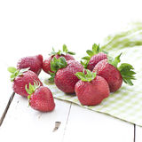 Fresh strawberries. Strawberries on green tea towel and white rustic table stock photography