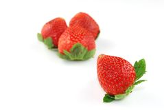 Fresh Strawberries. Isolated on White with Selective Focus in front Stock Photos