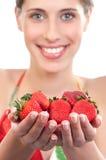 Fresh strawberries. Beautiful young woman holding fresh strawberries Stock Photos