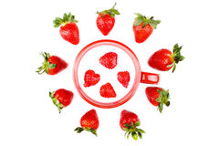 Fresh strawberries around cup of milk. On white background Royalty Free Stock Photography