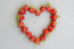 Fresh Strawberries Array Heart Shape Textured Gray Cement Background Vitamine summer Fruit royalty free stock photography