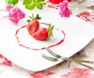 Fresh strawberries  as romantic dessert  on a plate in heart sha Stock Images