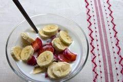Fresh strawberries, bananas and muesli Stock Photo