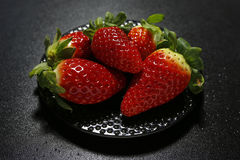 Fresh strawberries on black background Royalty Free Stock Images