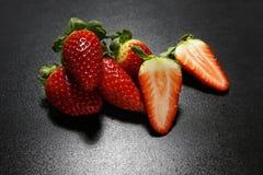 Fresh strawberries on black background Royalty Free Stock Image