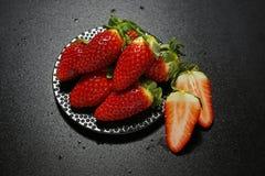 Fresh strawberries on black background Stock Images