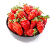 Fresh strawberries in a black cup Stock Images