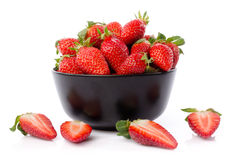 Fresh strawberries in a black cup Stock Photography