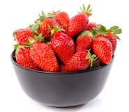 Fresh strawberries in a black cup Royalty Free Stock Photos