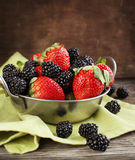 Fresh strawberries and blackberries in bowl Royalty Free Stock Images