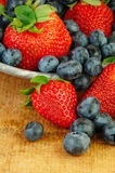 Fresh Strawberries and Blueberries in Colander Royalty Free Stock Photos