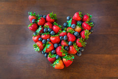 Fresh strawberries Blueberries Heart shape Royalty Free Stock Images