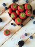 Fresh strawberries and blueberries in heart shape  Royalty Free Stock Photography