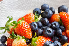 Fresh strawberries and blueberries Stock Photography
