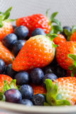 Fresh strawberries and blueberries Royalty Free Stock Photos