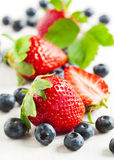 Fresh strawberries and blueberries. Royalty Free Stock Photo