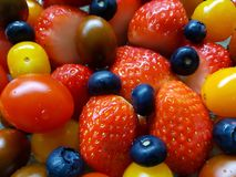 Fresh strawberries Blueberry tomatoes stock images