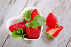 Fresh strawberries in a bowl. Ripe strawberry in ceramic bowl royalty free stock photos