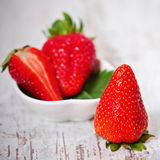 Fresh strawberries in a bowl. Ripe strawberry in ceramic bowl stock photos