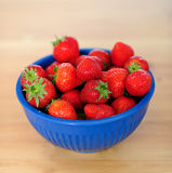 Fresh strawberries in a bowl Stock Images