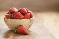 Fresh strawberries in bowl on wood table with copy space. Organic garden berries Royalty Free Stock Photography