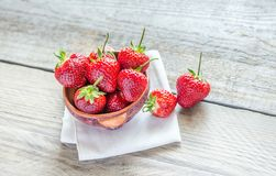 Fresh strawberries in the bowl on the wooden table Royalty Free Stock Photo