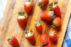 Fresh strawberries in a bowl on wooden table. Fresh strawberries in a bowl on a light wooden table stock photos