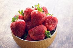 Fresh strawberries in a bowl on a wooden table. Fresh strawberries in a bowl on a wooden table. Vegetarianism, vegan Stock Images