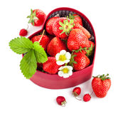 Fresh strawberries in box as heart with green leaf Royalty Free Stock Images