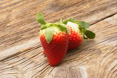 Fresh strawberries on the brown wooden table. Stock Images