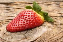 Fresh strawberries on the brown wooden table. Royalty Free Stock Photos