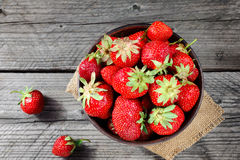 Fresh strawberries on the brown wooden table Royalty Free Stock Photography