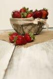 Fresh strawberries on burlap background Stock Photo