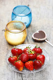 Fresh strawberries and cake pop in heart shape Stock Photos