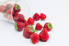 Fresh strawberries in clear glass stock images