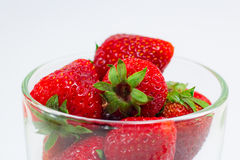 Fresh strawberries in clear glass royalty free stock photography