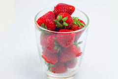Fresh strawberries in clear glass Royalty Free Stock Image