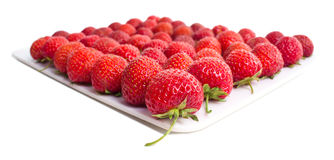 Fresh strawberries close up shoot on white surface Royalty Free Stock Image