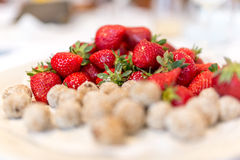 Fresh strawberries with coconut bites Royalty Free Stock Photography