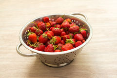 Fresh strawberries in a colander Royalty Free Stock Image