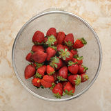 Fresh strawberries in a colander Stock Image
